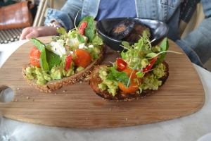 Chunky avocado & Persian feta with fresh chilli, mint & blistered cherry tomatoes on seeded toast