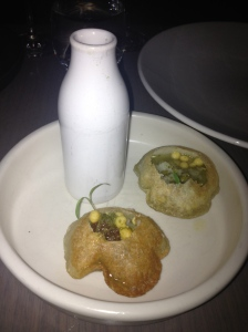 Pani puri, crispy parcel filled with spiced potato, mung beans, date and tamarind chutney with aromatic water