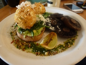 Dukkah Crusted Eggs, roasted mushrooms, avocado on sourdough with grilled lime and ricotta.
